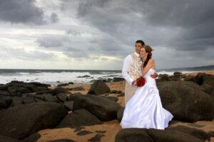 Bridal couple posing on the beach