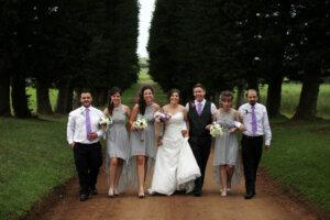 wedding couple walking with groomsmen and bridesmaids