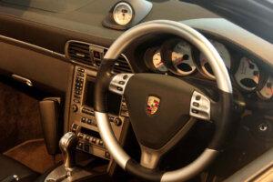 Drivers side interior and instruments of Porsche sportscar