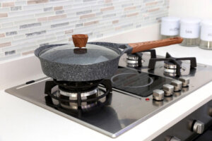 pot with tempered-glass lid on stove