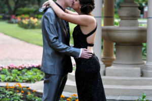 smartly dressed young couple kissing