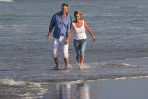 mature couple walking on the beach holding hands