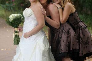 Bride posing with two bridesmaids