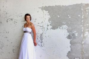 Bride posing against wall for Ballito wedding photographer