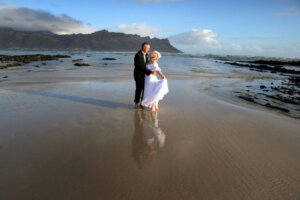 Wedding couple posing on Cape beach in South Africa
