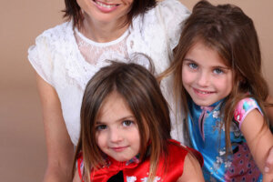 photography studio portrait of mom and two daughters