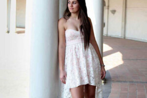 beautiful leggy brunette in white dress and high heals