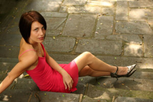 short haired brunette modelling red dress