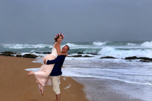 married couple on stormy beach
