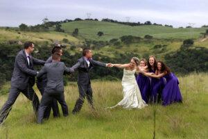 Groomsmen and Bridesmaids doing tug o war