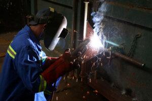 factory worker busy welding