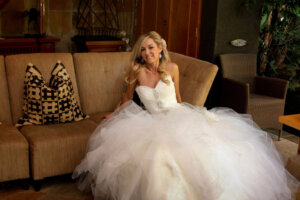 bride with beautiful wedding dress on couch