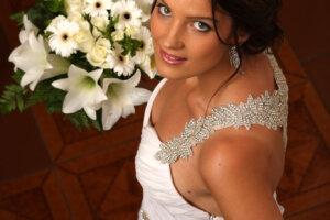 beautiful bride with white bouquet of flowers
