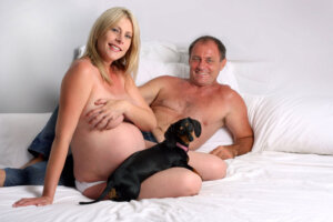 pregnant couple with Daschund