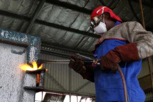 industrial welder busy with Oxy Acetylene gas-welding