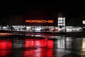 sportscar dealership at night Porsche