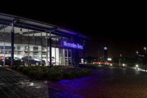 car dealership at night Mercedes Benz