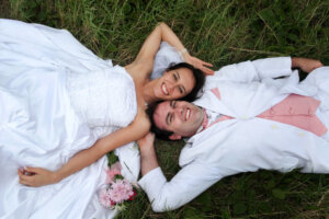 wedding couple lying next to each other