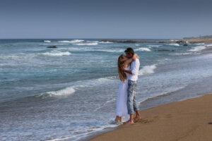 romantic couple kissing on the beach