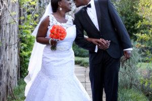 black wedding couple laughing