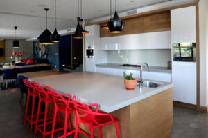 modern kitchen with red chairs