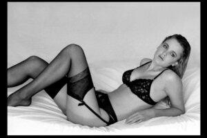 photo model posing in black lingerie in studio