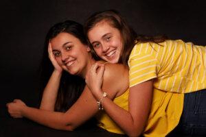 family studio portrait of two girls