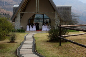 guests waiting for bride to arrive in quaint little wedding chapel