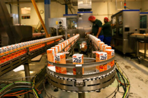 fruit juice boxes on assembly line at fruit juice factory