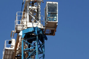 industrial crane operator busy working high up in the air