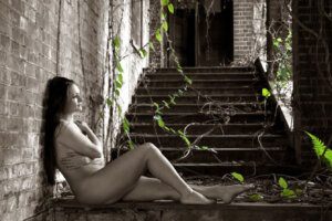 nude lady posing on stairs
