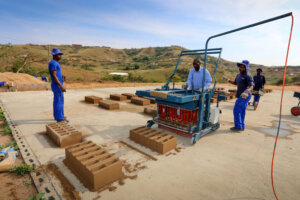 workers busy manufacturing house building bricks