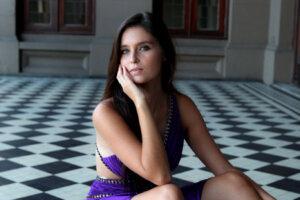 brunette in purple evening dress